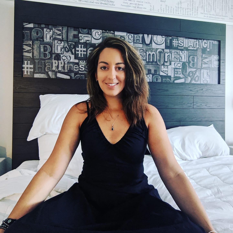 woman in black dress smiling